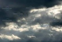 Купеста облачност и дъжд във вторник